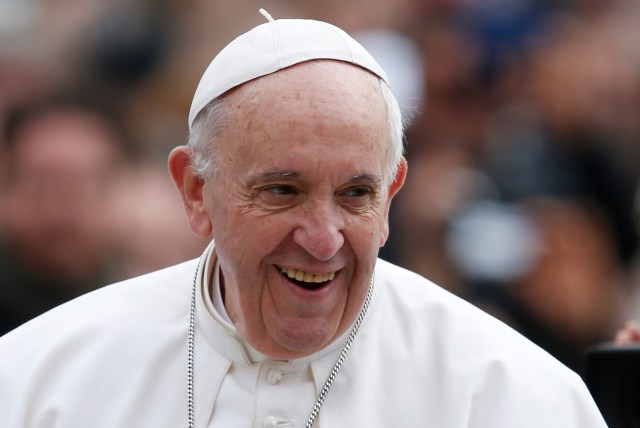 Pope Francis smiles during his general audience in St. Peter's Square at the Vatican March 22. (CNS/Paul Haring)