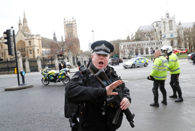 Armed police respond outside Parliament during a terror attack in London March 22. (CNS/Reuters)