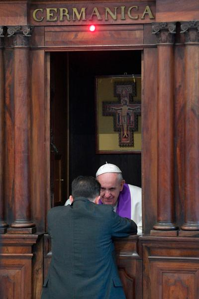 Pope Francis hears the confession of a priest during a meeting with priests of the Diocese of Rome at the Basilica of St. John Lateran in Rome March 2. (CNS/L'Osservatore Romano)