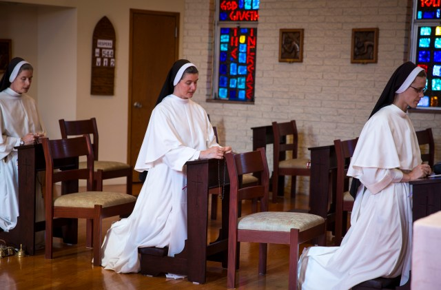 Dominican Sister Marie Bernadette Thompson, council coordinator for the Council of Major Superiors of Women Religious, center, prays the rosary with other women religious at their Washington convent. (CNS/Chaz Muth)