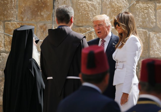 President Donald Trump and first lady Melania Trump talk to clergymen during their visit to Jerusalem's Church of the Holy Sepulcher May 22. (CNS/Reuters)