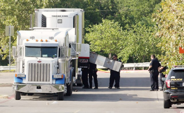 Police officers in San Antonio work a crime scene at Walmart July 23 after eight people were found dead inside an 18-wheeler truck. (CNS/Reuters)