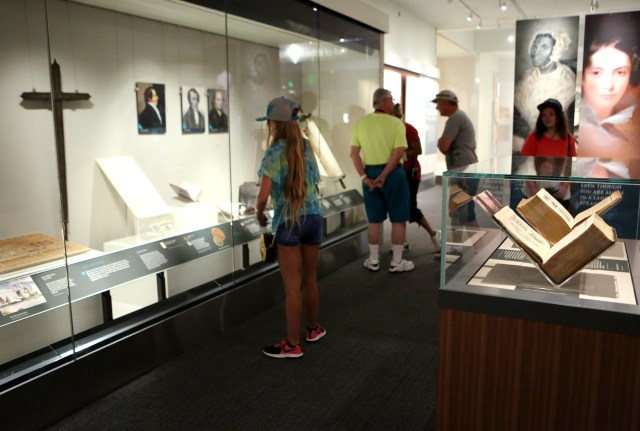 "Visitors at the Smithsonian Institution's National Museum of American History in Washington check out the exhibit ""Religion in Early America."" The exhibit will be on display until June 3, 2018. (CNS photo/Chaz Muth)"