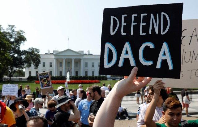 """Deferred Action for Childhood Arrivals supporters demonstrate near the White House in Washington Sept. 5 as U.S. Attorney General Jeff Sessions announced that the DACA program is """"being rescinded"""" by President Donald Trump. (CNS/Reuters)"""