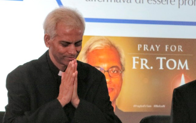 Salesian Father Tom Uzhunnalil, who was released from captivity Sept. 12, greets journalists as he arrives for a news conference in Rome Sept. 16. Father Uzhunnalil was abducted during an attack on a charity care home in Yemen in March 2016 and imprisoned for 18 months. (CNS/Junno Arocho Esteves)