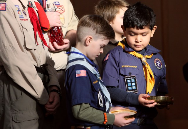 Cub Scouts participate in the presentation of the gifts during a Mass marking Scout Sunday at St. Joseph Church in Kings Park, N.Y., Feb. 5. The Boy Scouts of America's board of directors unanimously agreed Oct. 11 to allow girls into the Cub Scout program next year and let older girls become Eagle Scouts. (CNS/Gregory A. Shemitz)
