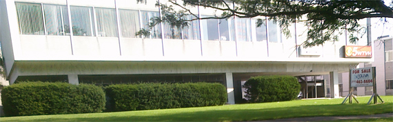 """In this CNYRadio.com file photo from August 2009, the WTVH sign is still on the front of the building.  Today, that sign is gone and a different """"For Sale"""" sign stands on the front lawn at 980 James Street in Syracuse."""