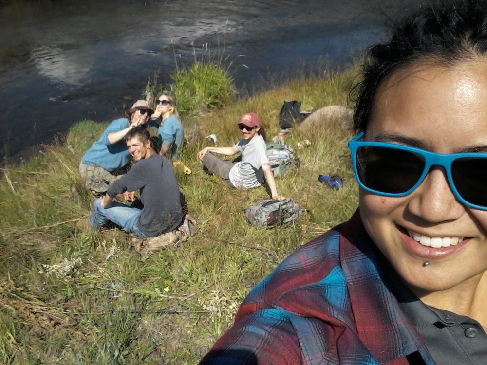 Volunteer group selfie by a river
