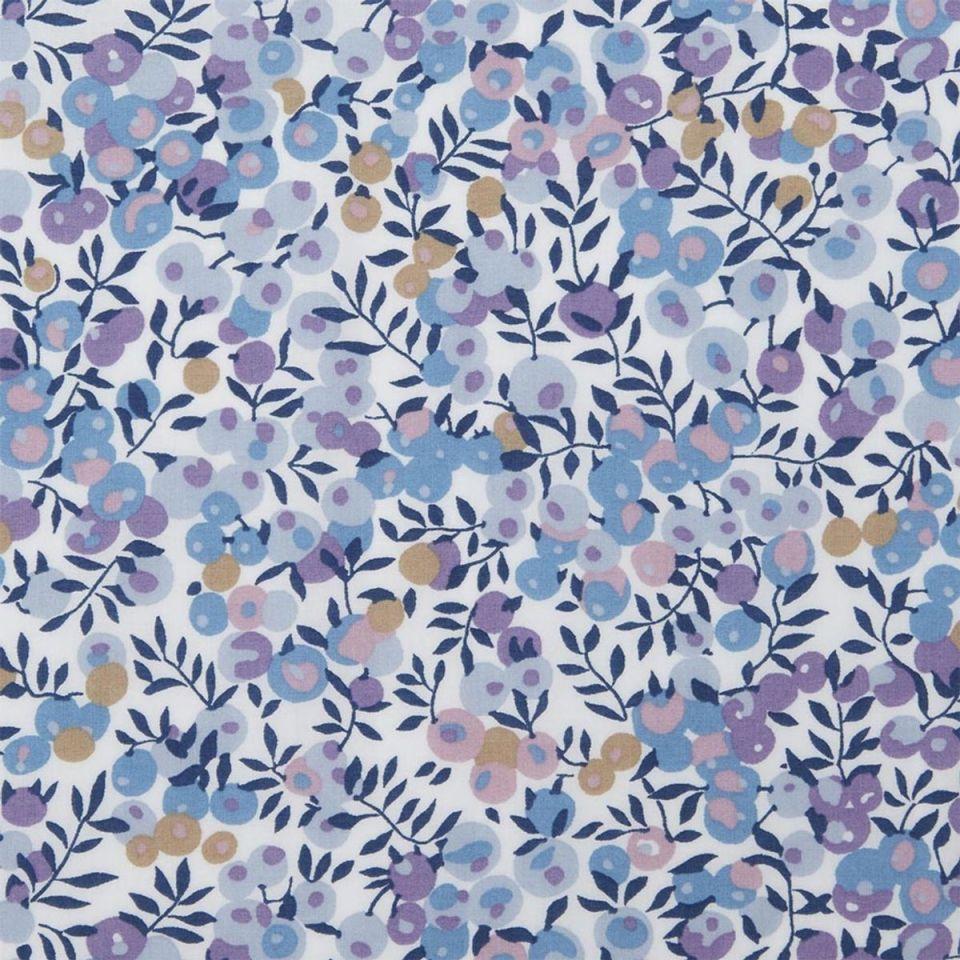 Tissu liberty à motifs fleurs bleues violettes
