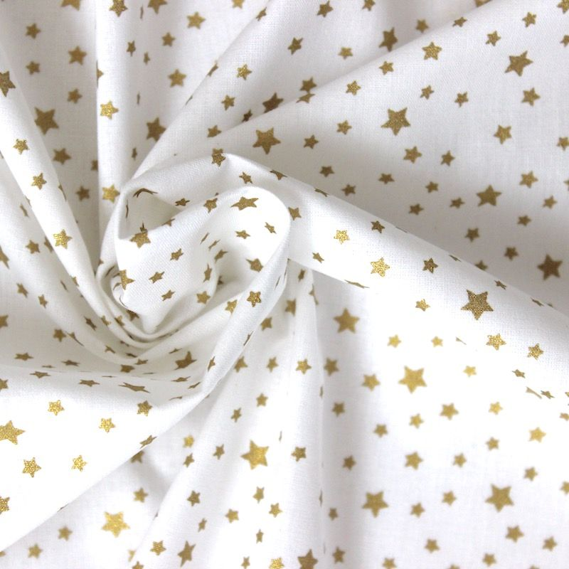 Tissu coton blanc à motifs étoiles brillantes or