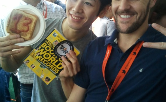 Joseph meeting competitive eating Champion Kobayashi at the GroupMe tent.