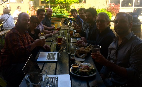 Portland digital strategy agency works at sunny tables.