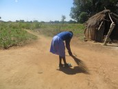 Scovia cleaning her grandma's compound