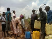 Beatrice, Sandra and Judith at the borehole