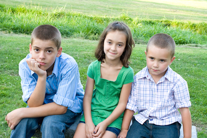 Kids sitting looking bored