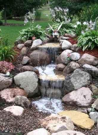 25 Stunning Backyard Ponds Ideas With Waterfalls (18)