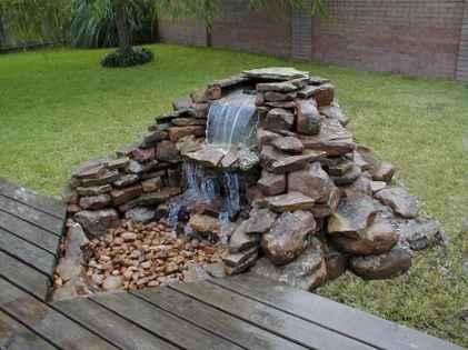 25 Stunning Backyard Ponds Ideas With Waterfalls (9)