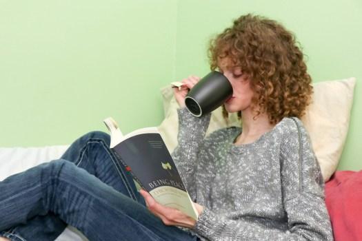 Drinking tea and reading