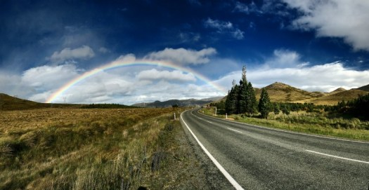 Rainbow over a road