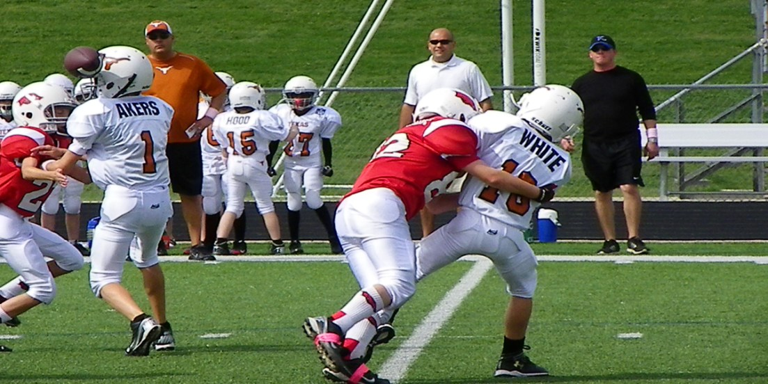 coaching youth football defense to hit hard