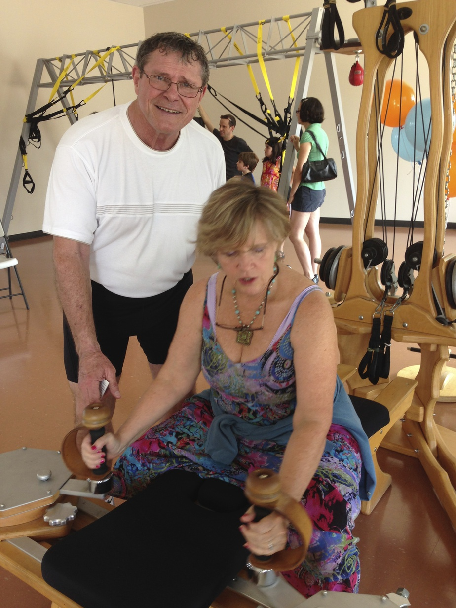 Randy Jones showing Moe how to use a Pilates reformer