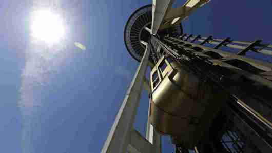 Seattle Space Needle elevator operator Michael Hall says despite the success of the attraction, his pay hasn't budged in four years. Ted S. Warren/AP