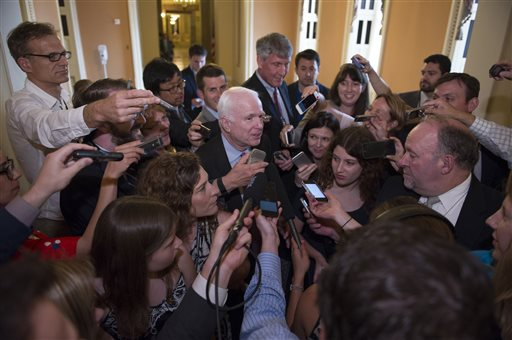 Sen. John McCain, R-Az., is surrounded by reporters as he walks to the Senate Chamber to begin a special session to extend surveillance programs, in Washington, Sunday, May 31, 2015. Senate Republicans say they've been unable to make a deal to extend contested anti-terror provisions. As a result, the post-Sept. 11 programs will expire at midnight. (AP Photo/Cliff Owen)