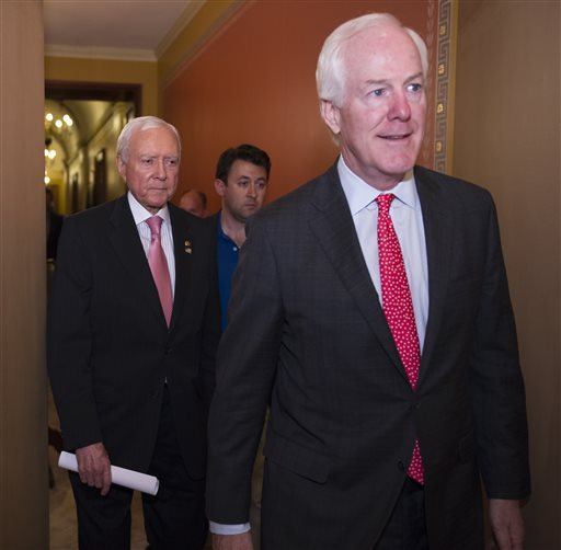 Sen. John Cornyn, R-Tx., right, and Sen. Orrin Hatch, R-Utah, depart a Republican Caucus before attending a special session of the Senate to extend surveillance programs,  in Washington, Sunday, May 31, 2015. Senate Republicans say they've been unable to make a deal to extend contested anti-terror provisions. As a result, the post-Sept. 11 programs will expire at midnight.  (AP Photo/Cliff Owen)