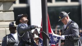 Crowd chants 'Take it down' as Confederate flag removed from South Carolina Capitol