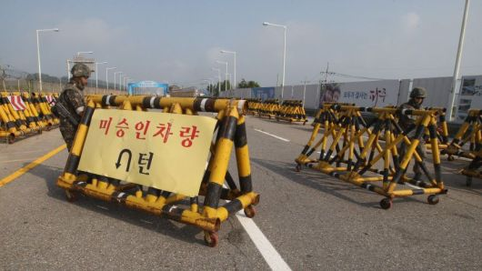 Aug. 22, 2015: South Korean army soldiers adjust barricades set up on Unification Bridge, which leads to the demilitarized zone, near the border village of Panmunjom in Paju, South Korea. (AP)