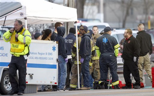 EMS workers gather a staging area by Excel Industries in Hesston, Kan., Thursday, Feb. 25, 2016, where a gunman killed an undetermined number of people and injured many more. (Fernando Salazar/The Wichita Eagle via AP)