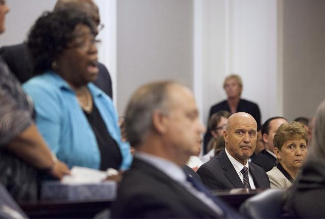 The parents of Michael Slager look on during an emotional plea from Judy Scott (L), mother of Walter Scott, to deny bond for former police officer Slager, in Charleston, South Carolina, in this September 10, 2015, file photo. REUTERS/Randall Hill/Files