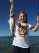 Granddaughter catching the Seatrout w/ Fish Face Charters!