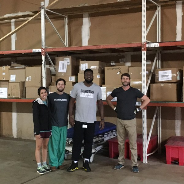 group of volunteers in warehouse