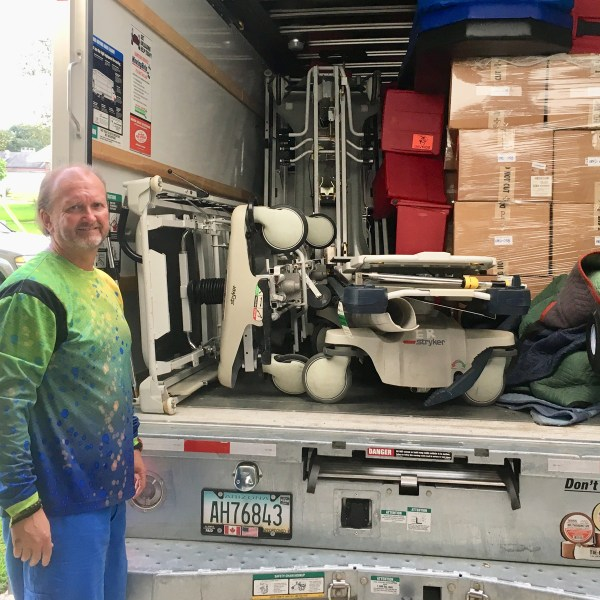 Stephen Wright with truck full of medical supplies