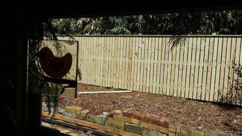 Wood semi-privacy fence with one inch gap