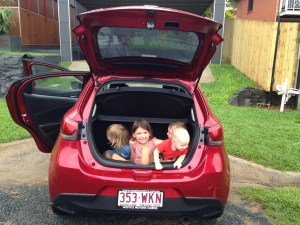 Photo of kids in the boot of our new car