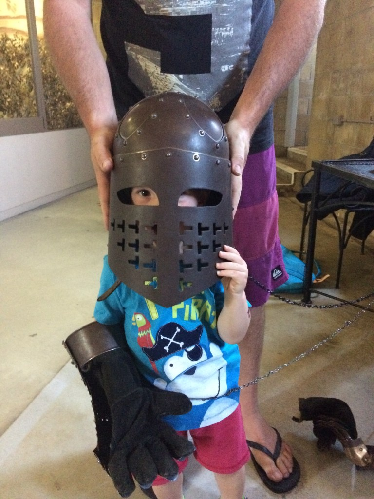 A toddler dressed up as a Knight