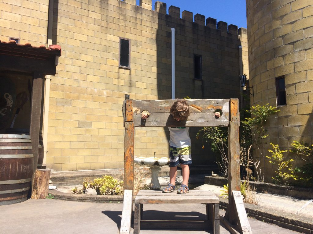 A boy in the stocks