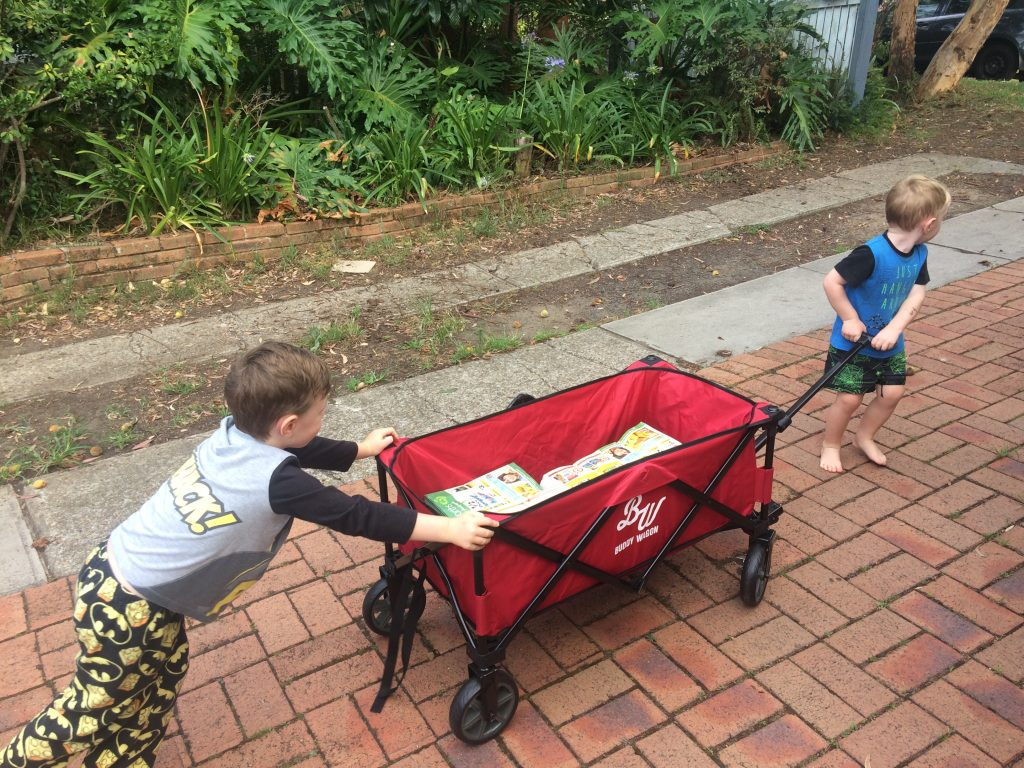 The kids pushing the Buddy Wagon