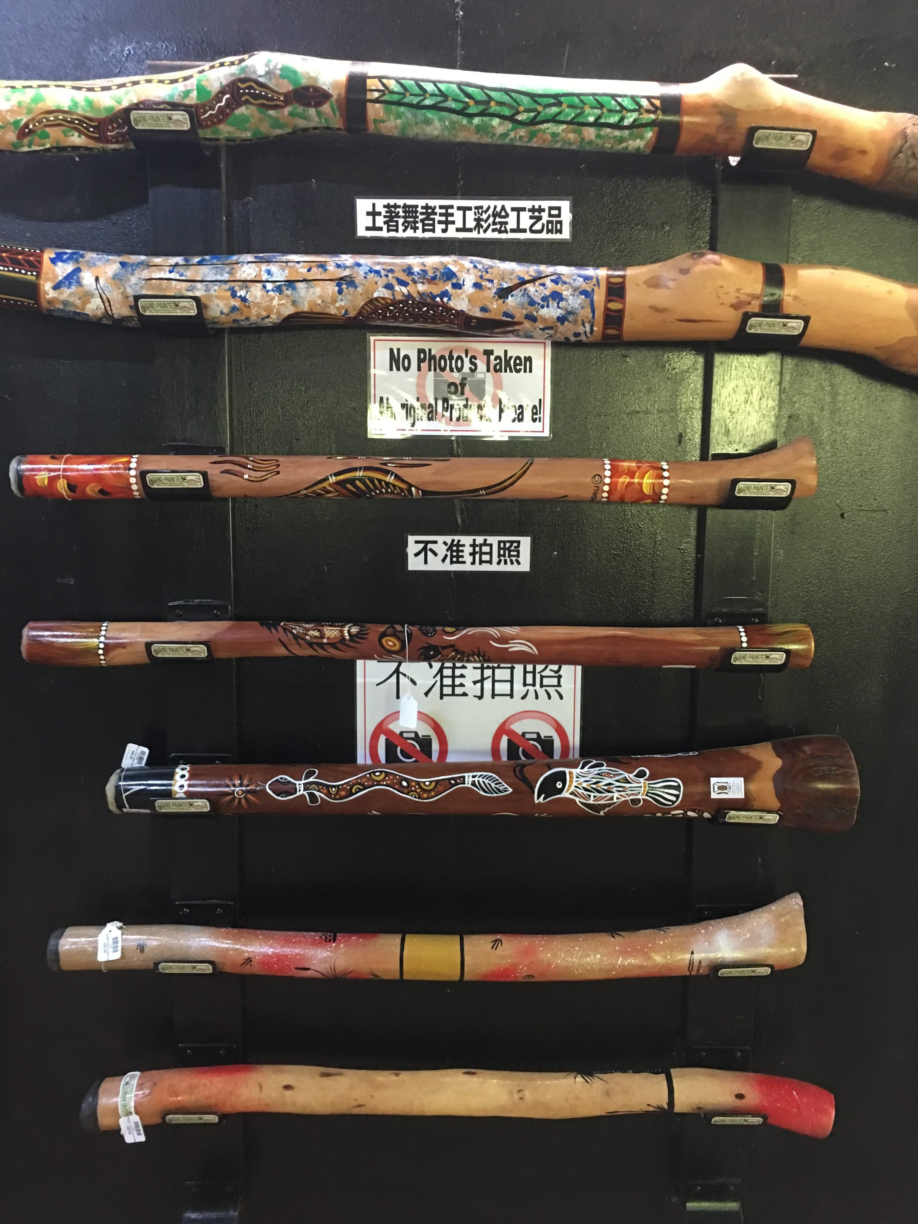 A display of indigenous hand painted didgeridoos