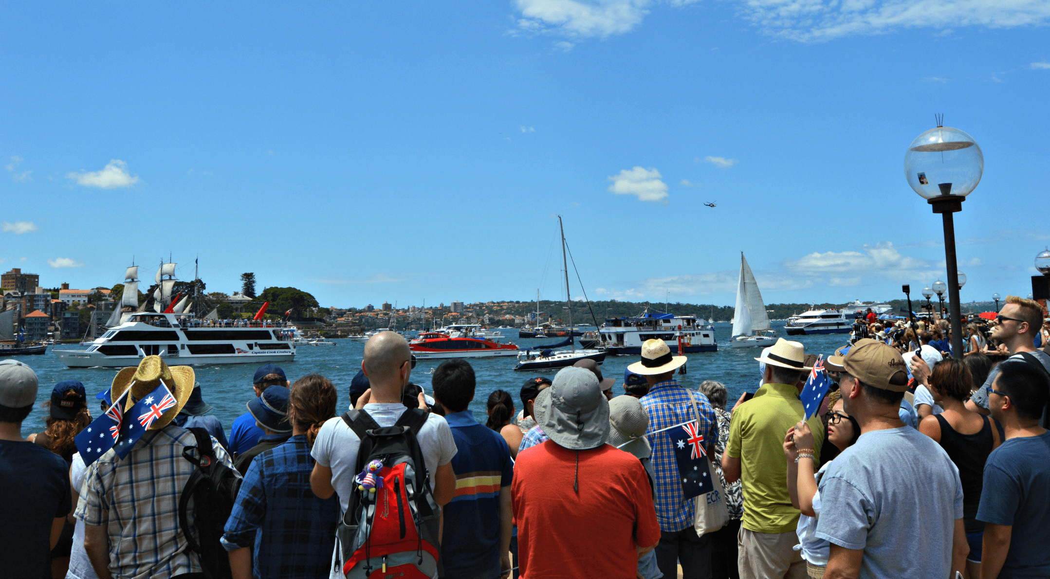 A crowd watching Australia Day celebrations in Sydney Harbour -  travel Australia with kids