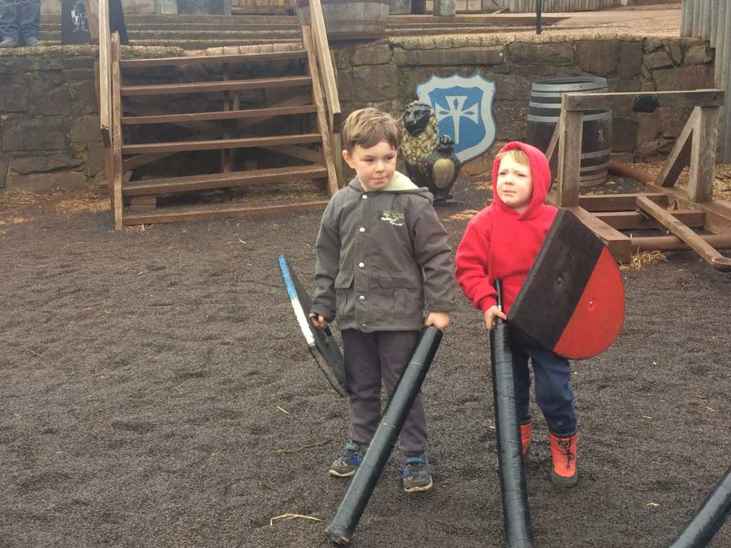 2 young boys at Kryal Castle with swords and shields