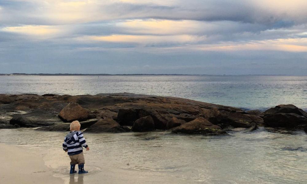 Child splashing in the water in Augusta, Western Australia