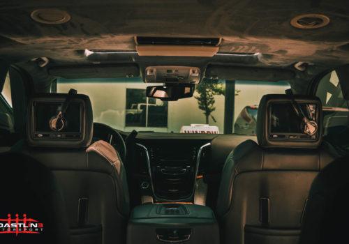 Cadillac Escalade w/ Headrest Screens and Headphones