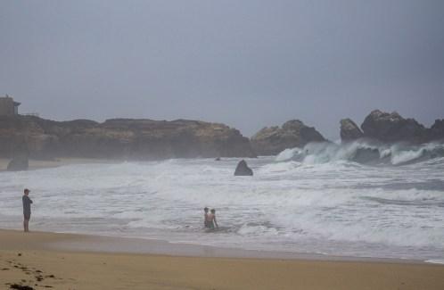 Children wading in front of 12 ft waves at Garrapata State Beach. Eek! Dawn Page/CoastsideSlacking