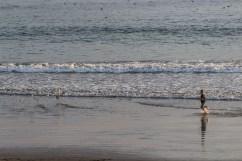 A boy attempts a game of tag at Surfer's Beach near Half Moon Bay. Dawn Page / CoastsideSlacking