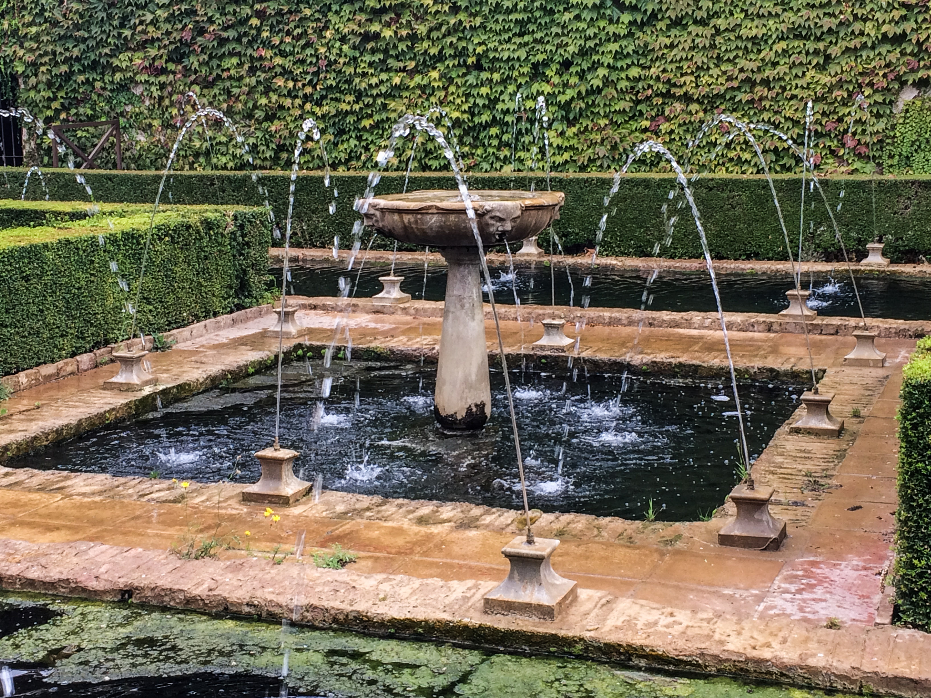 Gardens of the Generalife, Alhambra's summer palace in Granada, Spain. Dawn Page / CoastsideSlacking