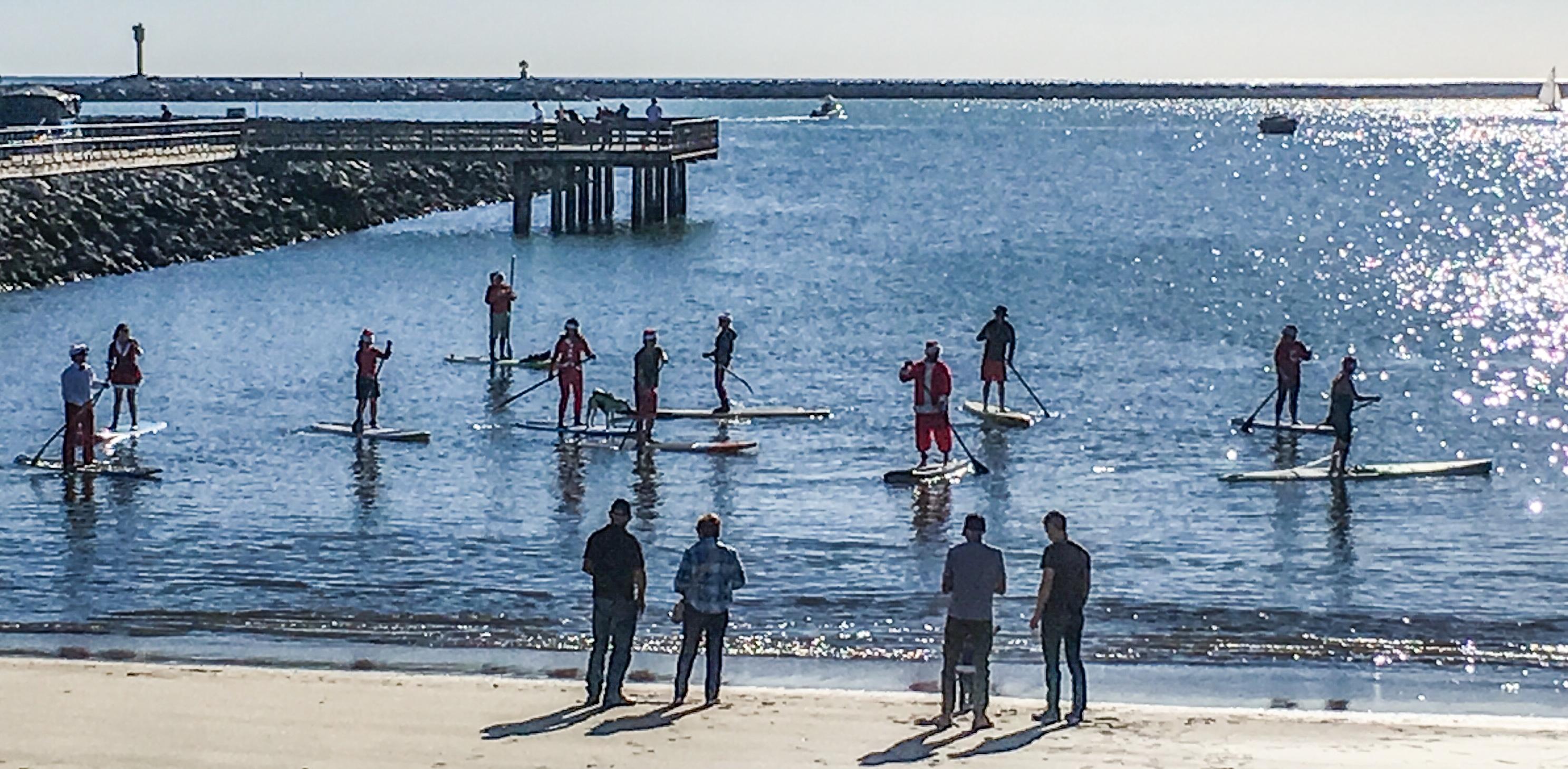 Paddle boarding Santas at the Half Moon Bay Yacht Club Dan Page / CoastsideSlacking