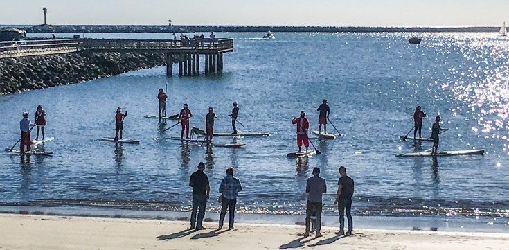 Paddle boarding Santas at the Half Moon Bay Yacht Club Dan Page / CoastsideSlacking